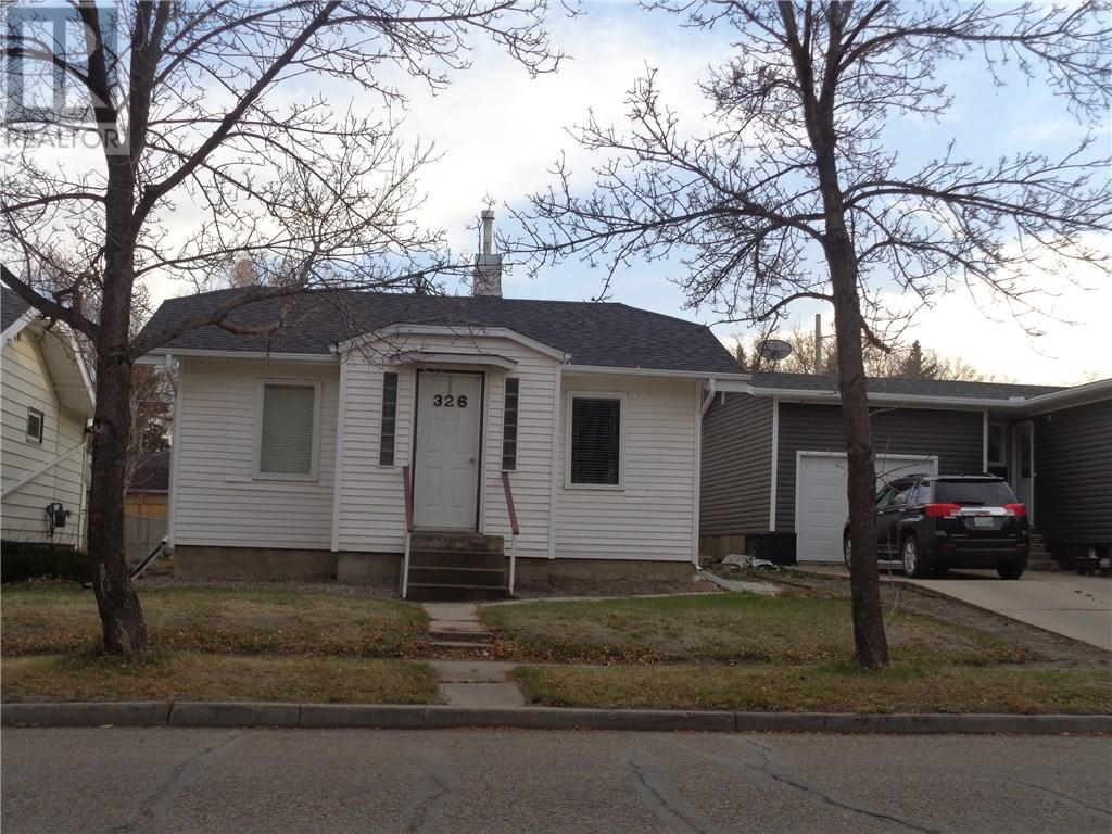 326 4th Ave E, Assiniboia, Saskatchewan  S0H 0B0 - Photo 1 - SK710074