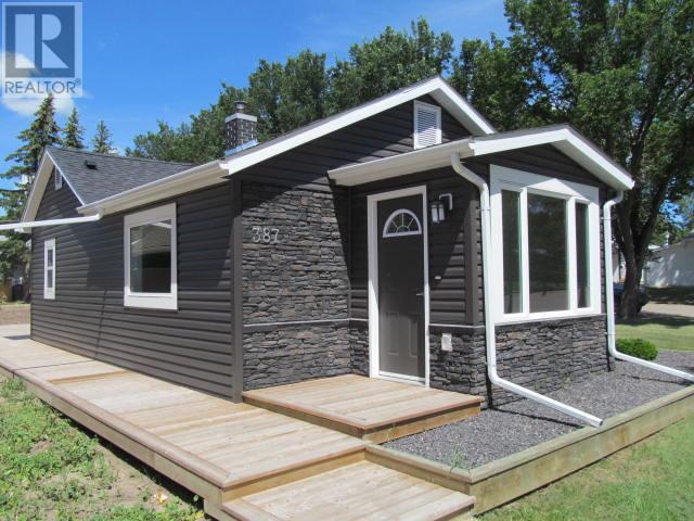 387 3rd Ave E, Shaunavon, Saskatchewan  S0N 2M0 - Photo 1 - SK718509