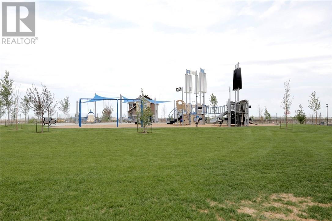 3257 Green Water Dr, Regina, Saskatchewan  S4V 3R6 - Photo 28 - SK720478